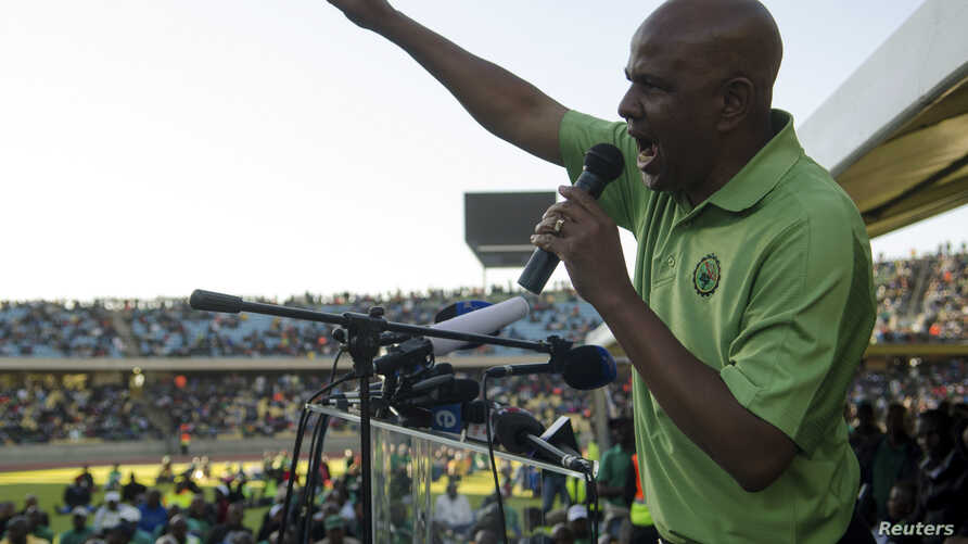 The Association of Mineworkers and Construction Union (AMCU) President Joseph Mathunjwa speaks to striking mine workers at the Royal Bafokeng Stadium in Rustenburg, June 23, 2014.