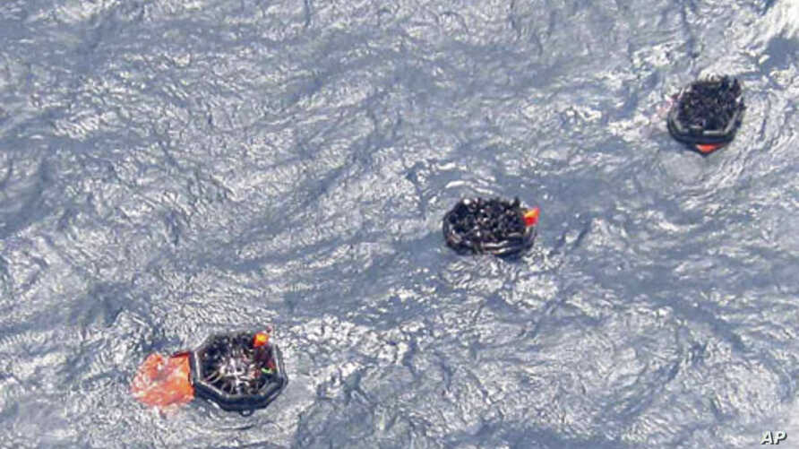 Life rafts carrying survivors float on rough waters after the MV Rabaul Queen ferry sank off Papua New Guinea February 2, 2012.