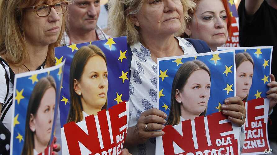 People rally in support of Lyudmyla Kozlovska, a Ukrainian activist banned from the entire Schengen zone due to a Polish request, in Warsaw, Poland, on Aug. 23, 2018.
