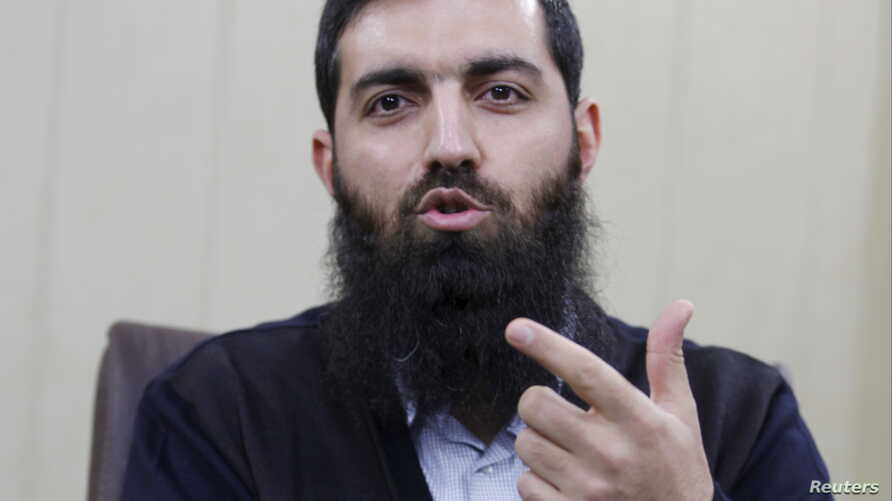 FILE- Halis Bayancuk, a Turkish cleric detained several times on suspicion of aiding al-Qaida, in Istanbul, Turkey, March 22, 2015. Bayancuk, 31, also known as Abu Hanzala, has cautioned Ankara against taking a more active role in the U.S.-led fight