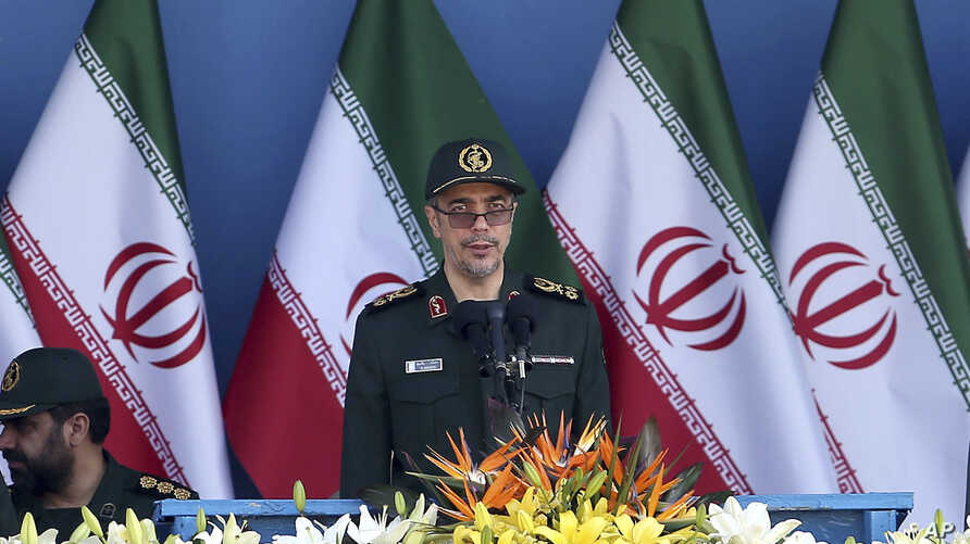 FILE - In this Sept. 21, 2016 file photo, Chief of Staff of Iran's Armed Forces, General Mohammad Hossein Bagheri delivers a speech during a military parade. On May 8, 2017, Bagheri was quoted as saying soldiers will attack terrorists wherever they a