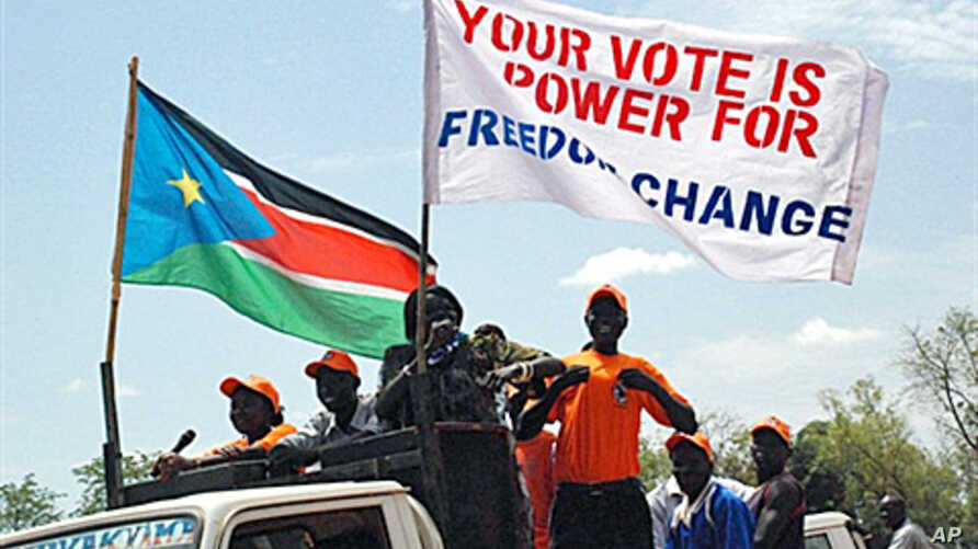 Southern Sudanese hold pro-independence banners as they march through the streets of the southern capital Juba, 9 Oct 2010.