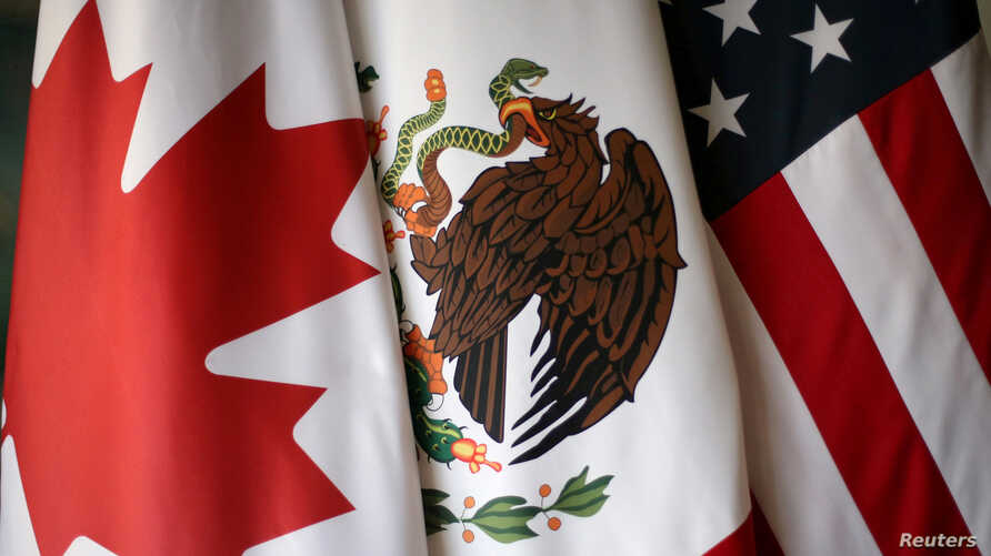 FILE - Flags are pictured during the fifth round of NAFTA talks involving the United States, Mexico and Canada, in Mexico City, Mexico, November 19, 2017.