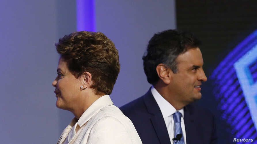 Brazil's presidential candidates Aecio Neves (R) of Brazilian Social Democratic Party (PSDB) and Dilma Rousseff of Workers Party (PT) take part in a TV debate in Rio de Janeiro Oct. 2, 2014.