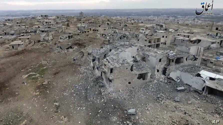 This image taken from drone footage posted online Jan. 2, 2017 by the Aamaq News Agency, a media arm of the Islamic State group, purports to shows an aerial image of a neighborhood damaged by Turkish airstrikes in the northern Syrian town of al-Bab.