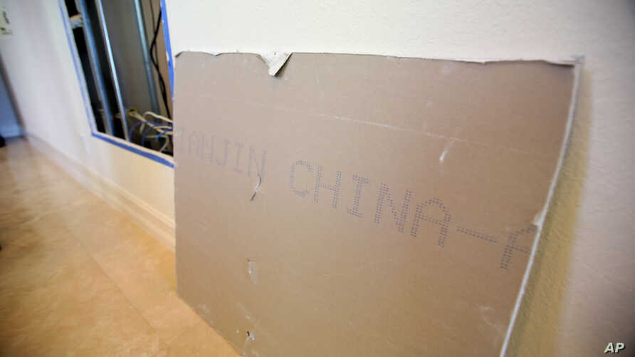 FILE - A large chunk of Chinese drywall from the Alfonso Sanchez home in Davie, Fla. leans against the wall, Oct. 15, 2009.