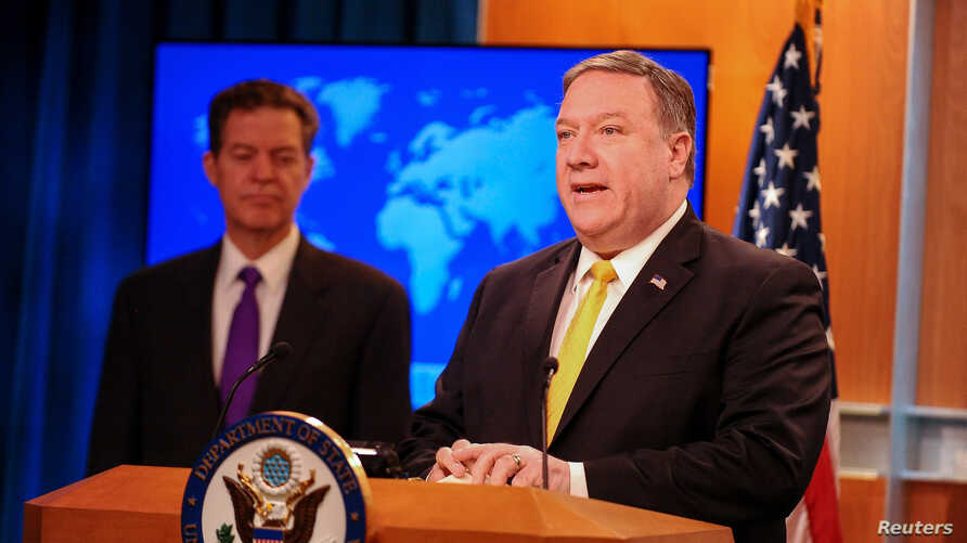 U.S. Secretary of State Mike Pompeo (R) and Ambassador-at-Large for International Religious Freedom Sam Brownback release and the department's annual report on religious freedom around the world, in Washington, May 29, 2018.