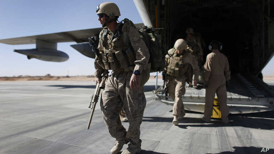 FILE - U.S. Marines are seen disembarking from a C-130 transport plane.