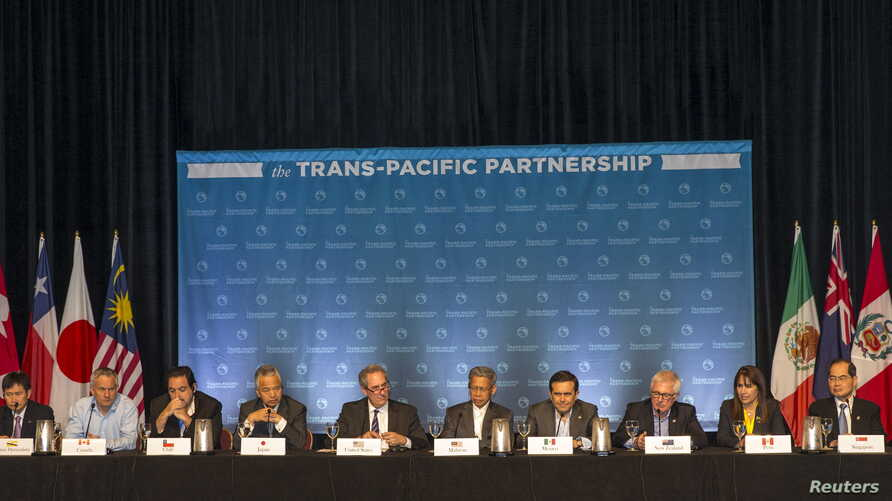 The 12 Trans-Pacific Partnership (TPP) Ministers hold a press conference to discuss progress in the negotiations in Lahaina, Maui, Hawaii, July 31, 2015.