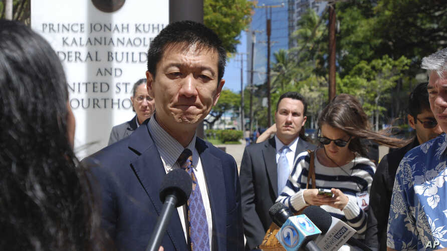 FILE - Hawaii Attorney General Douglas Chin speaks outside federal court in Honolulu, March 29, 2017.
