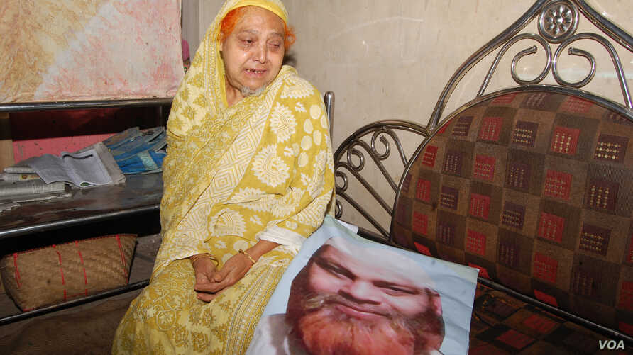With the photo of Habibur Rahman, his mother sits in at her Chittagong home a day after he was killed May 18 in the ongoing anti drug campaign in Bangladesh. Family members of Rahman insist that he was a religious man and had had no connection with n