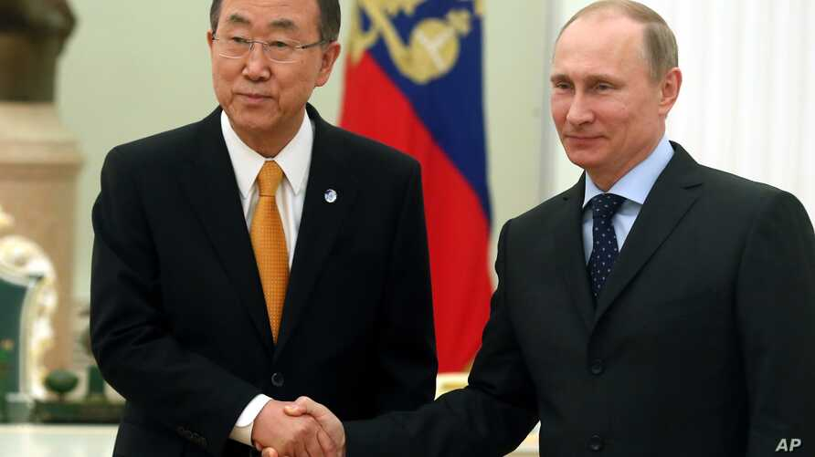 Visiting United Nations Secretary-General Ban Ki-moon, left, shakes hands with Russian President Vladimir Putin during their meeting in Moscow's Kremlin, Russia, March 20, 2014.