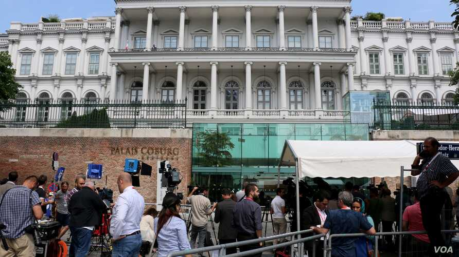 Journalists gather in front of the Palais Coburg, the venue for Iran nuclear talks in Vienna, Austria, July 2, 2015.