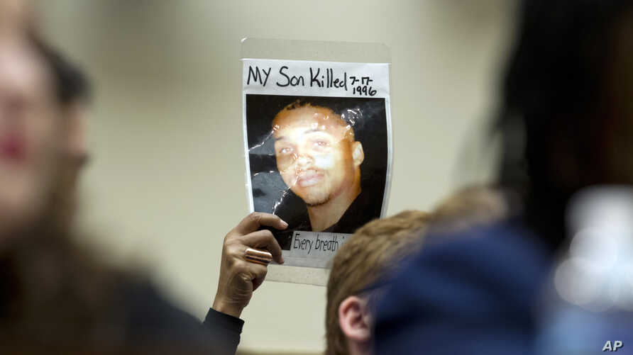 Mattie Scott holds up a picture of her son George during a hearing of the House Judiciary Committee on gun violence at Capitol Hill in Washington, Feb. 6, 2019.