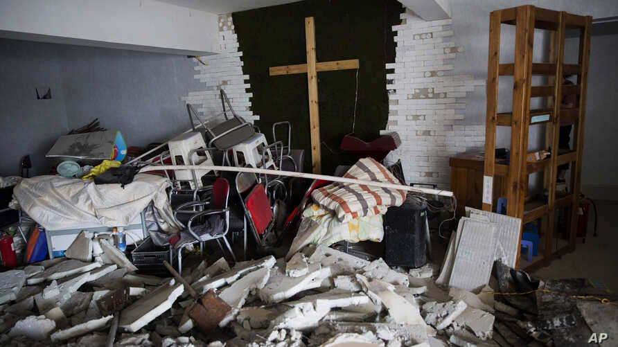 FILE - A demolished house church is seen in the city of Zhengzhou in central China's Henan province, June 3, 2018.