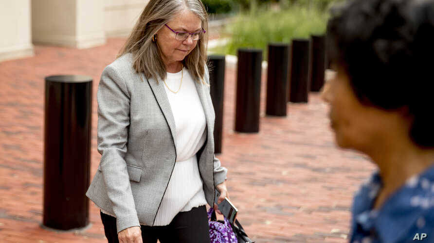 Tax preparer Cindy Laporta leaves the Alexandria Federal Courthouse in, Alexandria, Va., Aug. 3, 2018, on day four of Paul Manafort's tax evasion and bank fraud trial.