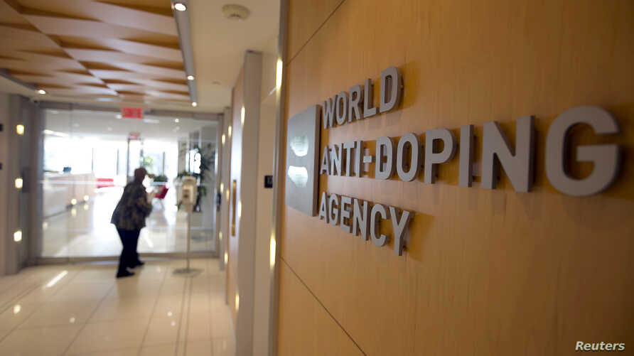 FILE - A woman walks into the head office of the World Anti-Doping Agency (WADA) in Montreal, Quebec, Canada November 9, 2015.