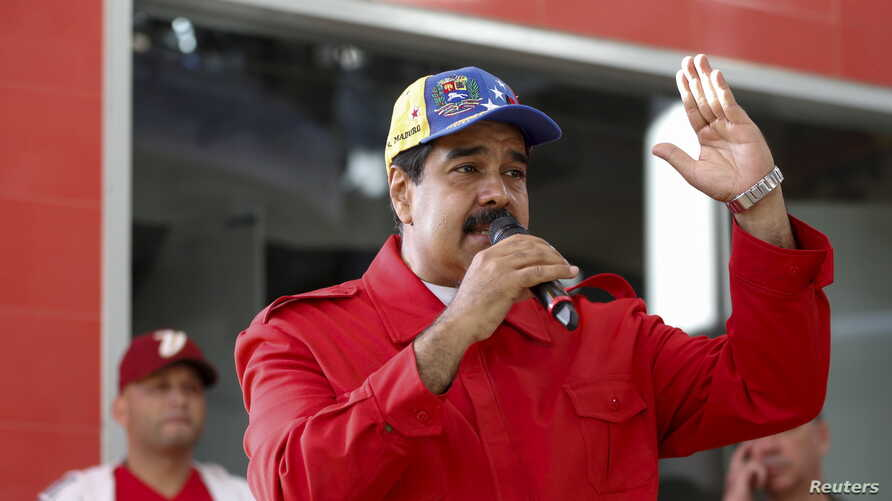 Venezuela's President Nicolas Maduro speaks during a meeting with supporters in the Petare slum district of Caracas, ahead of impending elections in the country, Dec. 1, 2015.