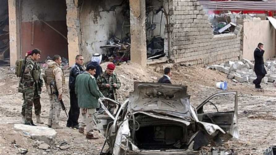 Iraqi security forces inspect scene of the attack near Mosul, Jan. 16, 2012.