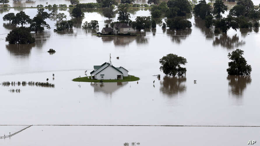 Homes surrounded by floodwaters are shown in this aerial view, in Rosharon, Texas, June 4, 2016.