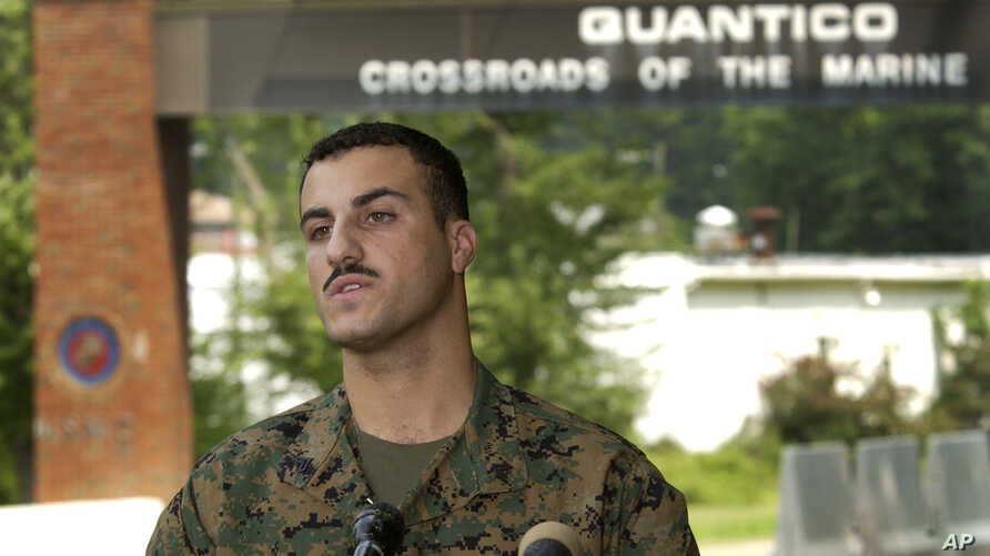 Marine Cpl. Wassef Ali Hassoun makes a statement to the press outside Quantico Marine Base in Quantico, Va., Monday July 19, 2004. Hassoun, who disappeared under mysterious circumstances while on duty in Iraq, insisted on Monday that he was captured