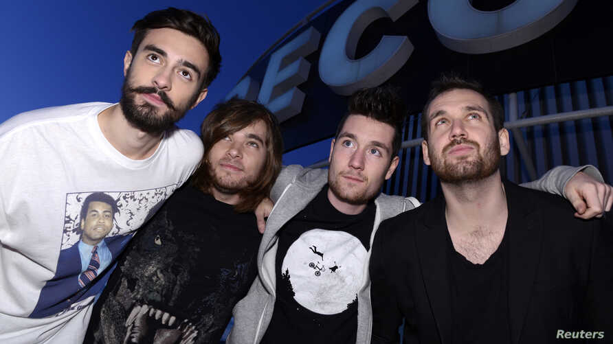 (From L to R) Members of the British electro-pop band Bastille, Kyle Simmons, Chris 'Woody' Wood, Dan Smith and Will Farquarson, pose for pictures at Capitol Studios in Los Angeles, December 5, 2013.