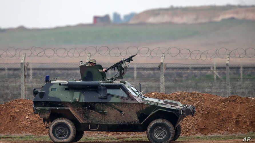FILE - A Turkish military vehicle is seen patrolling the Turkey-Syrian border near the Akcakale border crossing in Turkey, Jan. 31, 2015.