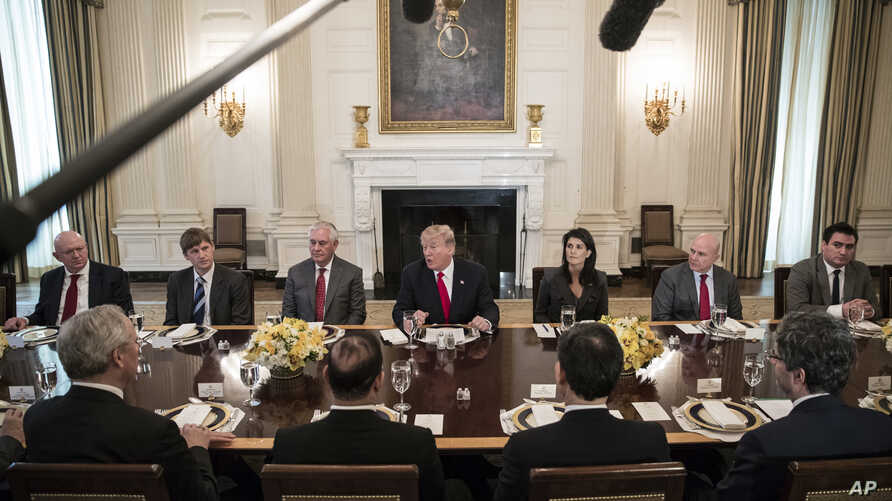 President Donald Trump (center) speaks during a luncheon with envoys representing countries of the United Nations Security Council, in the State Dining Room of the White House in Washington, Jan. 29, 2018.