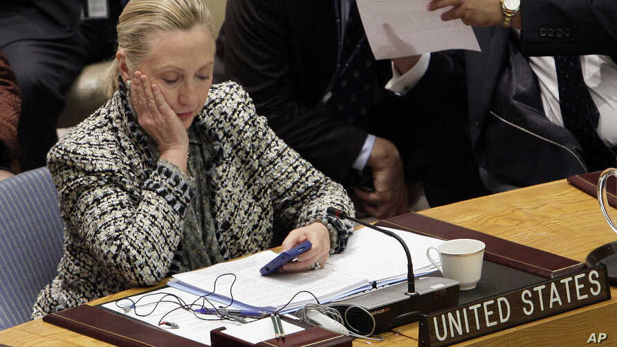 Campaign 2016 Clinton Emails: FILE - In this March 12, 2012, file photo, then-Secretary of State Hillary Clinton checks her mobile phone after her address to the Security Council at United Nations headquarters. In a rare step, the FBI on Friday, Sept...
