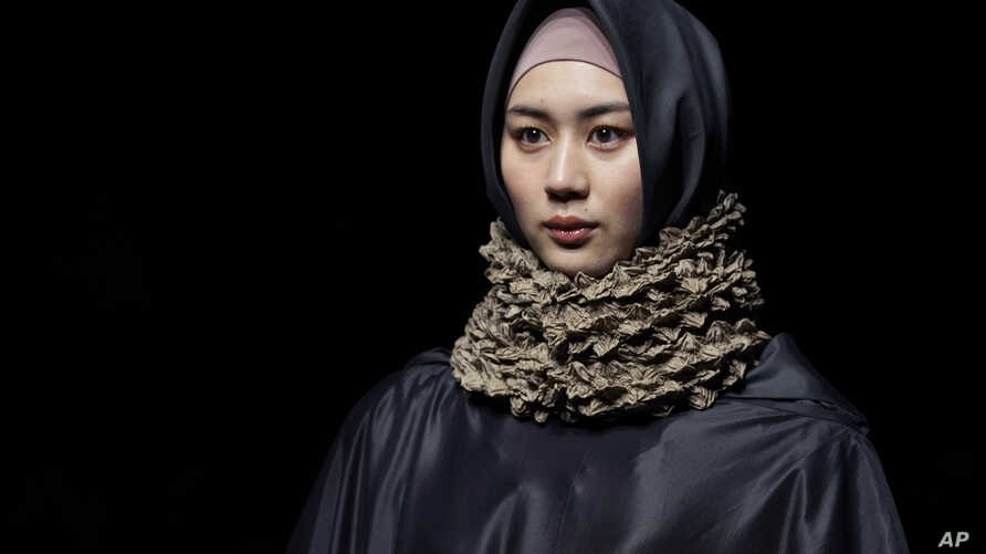 A model displays a creation by Anandia Marina Putri and Novita Yunus of Indonesia during the 2018 Autumn/Winter Collection at the Tokyo Fashion Week in Tokyo, Tuesday, March 20, 2018.