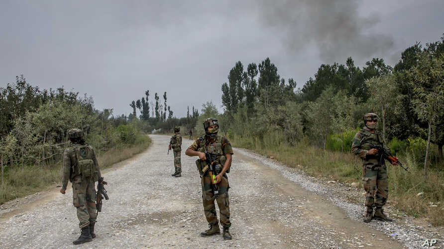 Indian army soldiers stand guard near the site of a gunbattle in Pulwama, about 35 kilometers south of Srinagar, in Indian-controlled Kashmir, Aug. 26, 2017.
