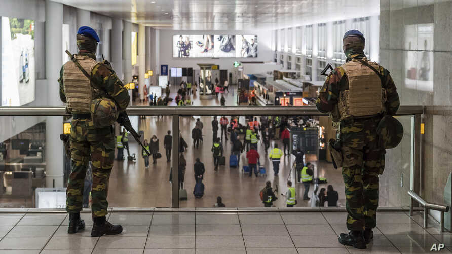 Soldiers patrol in the departure terminal, during the one-year anniversary service at Zaventem Airport in Brussels, March 22, 2017. The suicide bombings at the Brussels airport and subway on March 22, 2016, killed 32 people and wounded more than 300