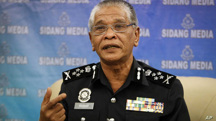 Malaysian police Deputy Inspector Gen. Noor Rashid Ibrahim gestures as he speaks during a press conference at the police headquarters in Kuala Lumpur, Malaysia Wednesday, Sept. 23, 2015.