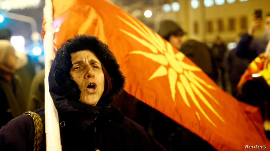 FILE - Supporters of the movement boycotting the deal with neighboring Greece to change the country's name to the Republic of North Macedonia protest in front of the parliament building during parliamentary debates on constitutional amendments relate