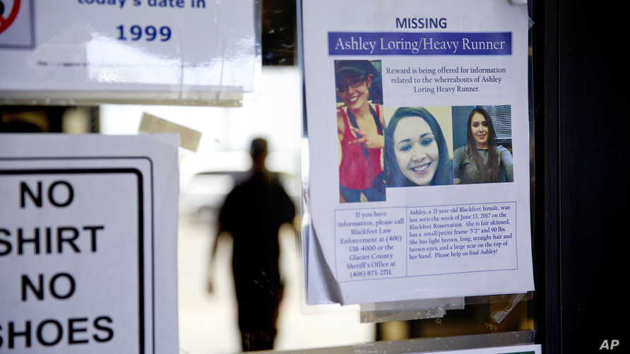 A missing poster for Ashley HeavyRunner Loring is posted to the entrance of a grocery store on the Blackfeet Indian Reservation in Browning, Mont., Thursday, July 12, 2018.