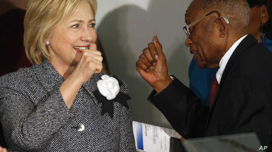 Democratic presidential candidate Hillary Clinton greets and gives a thumbs-up to Fred Gray, Rosa Parks' former attorney, before speaking at the Dexter Avenue King Memorial Baptist Church, Dec. 1, 2015, in Montgomery, Alabama
