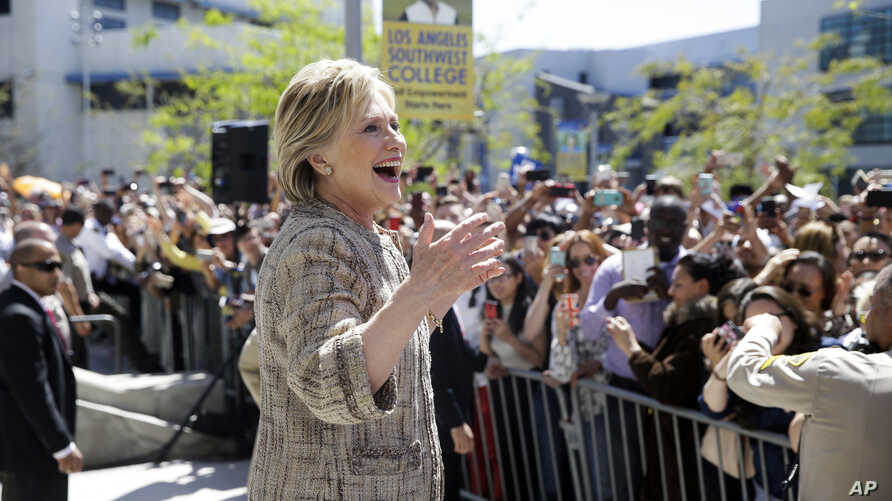 FILE - Democratic presidential candidate Hillary Clinton speaks to people in the overflow area during a campaign event at Los Angeles Southwest College in Los Angeles, April 16, 2016.