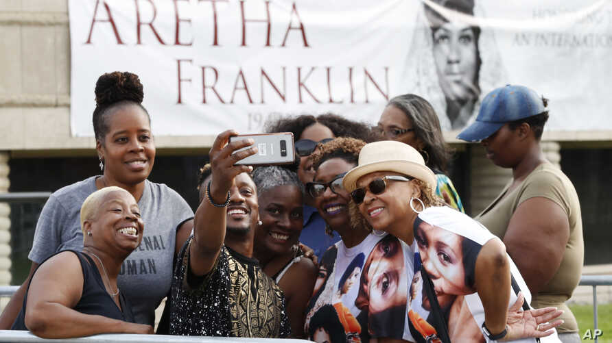 Sir Diego Brazil takes a selfie with some of the fans waiting to pay their final respects to Aretha Franklin at the Charles H. Wright Museum of African American History, Tuesday, Aug. 28, 2018, in Detroit.