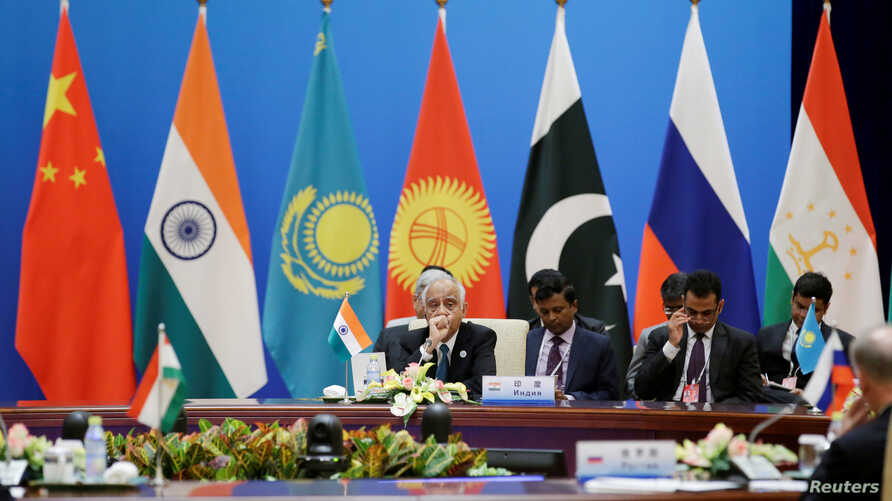 Indian delegation attend a plenary meeting of the Shanghai Cooperation Organization (SCO) security secretary summit in Beijing, China, May 22, 2018.
