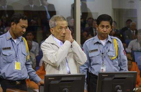 Former Khmer Rouge prison chief Kaing Kek Iev alias Duch (C) greets the court during his appeal hearing at the Court Room of the Extraordinary Chambers in the Courts of Cambodia on the outskirts of Phnom Penh, February 3, 2012.