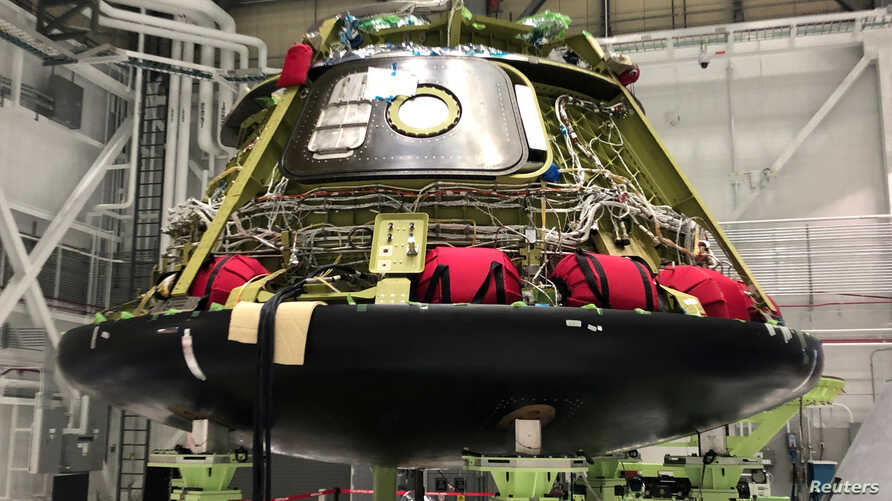 FILE - One of Boeing Co's CST-100 Starliner astronaut capsules is seen at a production facility in Cape Canaveral, Florida, Jan. 15, 2019.