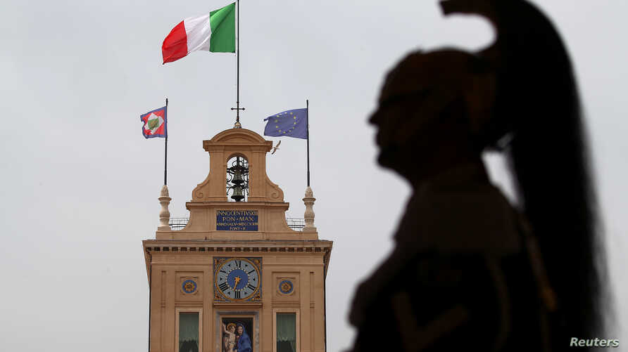A member of the Italian elite military unit Cuirassiers' Regiment, who are honor guards for the Italian president, stands guard inside the Qurinal palace before Carlo Cottarelli meeting with Italy's President Sergio Mattarella at the Quirinal Palace