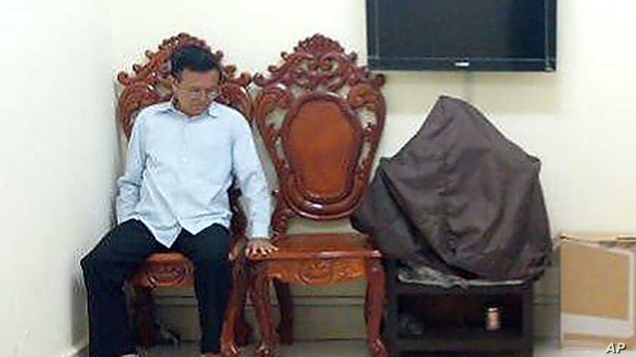 Former opposition leader Kem Sokha sits at the appeals court during the hearing of a bail application in Phnom Penh, Cambodia, Feb. 1, 2018.