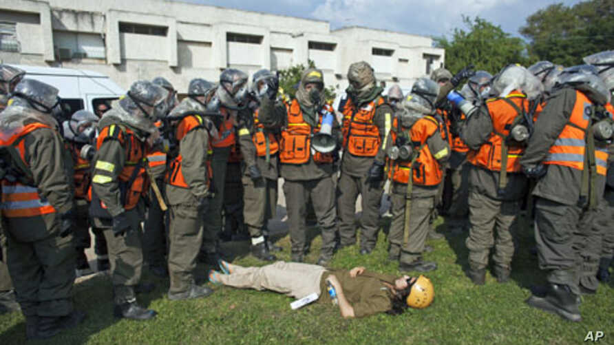 An Israeli soldier role playing as a mock victim lies on the ground during a drill simulating a missile attack in Holon near Tel Aviv November 3, 2011.