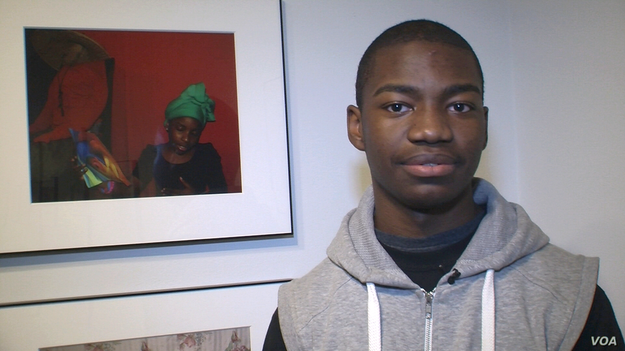Christopher Neal with one of his photographs in the Studio Museum of Harlem's student show. (Carolyn Weaver/VOA)