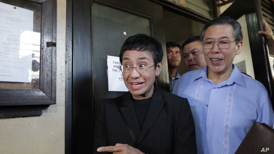 Maria Ressa, head of the Philippine online news site Rappler, gestures as she walks outside the Regional Trial Court branch 46 in Manila, Philippines on March 1, 2019.