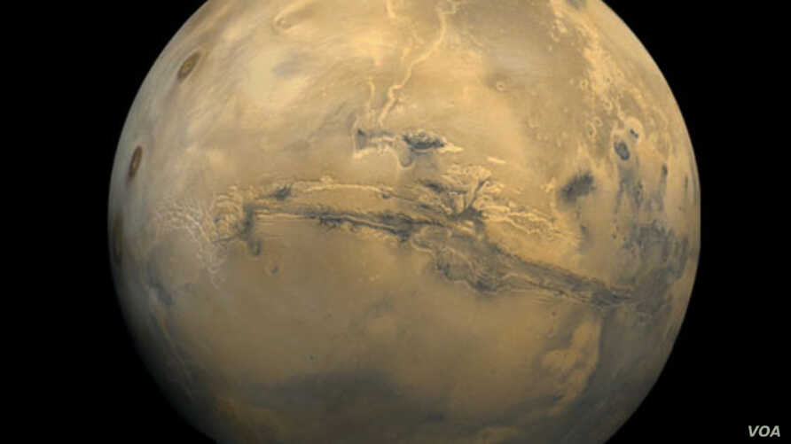 The largest canyon in the Solar System cuts a wide swath across the face of Mars. Named Valles Marineris, the grand valley extends more than 3,000 kilometers long, spans as much as 600 kilometers across, and delves as much as 8 kilometers deep. Photo