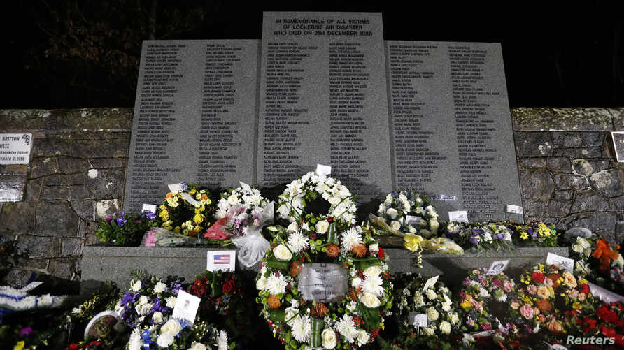 Wreaths are laid at a memorial event on the 25th anniversary of the bombing of Pan Am flight 103, in the Dryfesdale Cemetery, in Lockerbie, Scotland Dec. 21, 2013.