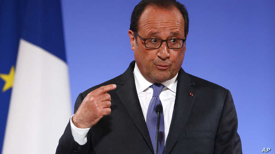 "French President Francois Hollande gestures as he addresses French ambassadors in Paris, Aug. 30, 2016. Hollande said U.S.-EU trade talks ""have bogged down, the positions have not been respected, the imbalance is obvious."""