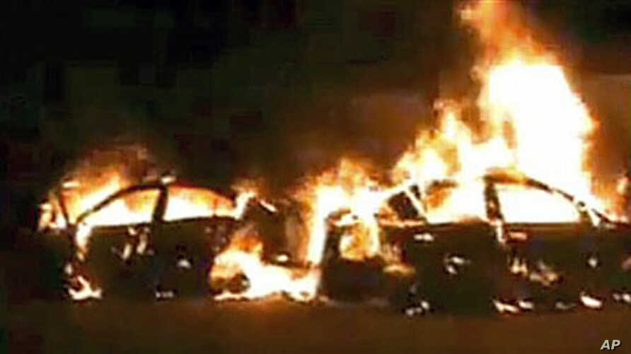 Image taken from amateur video shows burning cars after being attacked by supporters of Syrian President Bashar al-Assad, in Homs Syria, December 13, 2011.